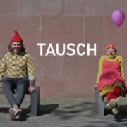 Zwei Clowns mit Luftballons und dem Schriftzug Tausch