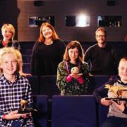 Das Team rund um die 3 Dinos im Filmhaus-Kino